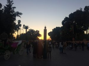 Koutoubia Mosque in Marrakesh, Morocco at sunset viewed from the Medina. The largest in the city
