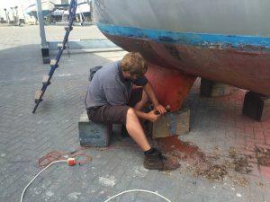 preparing for antifouling on a bilge keel sail boat