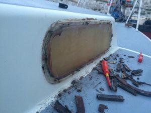 removing window Macwester bilge keel sailing boat during refurbishment