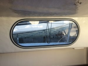 Replacement window in a bilge keel sailing yacht