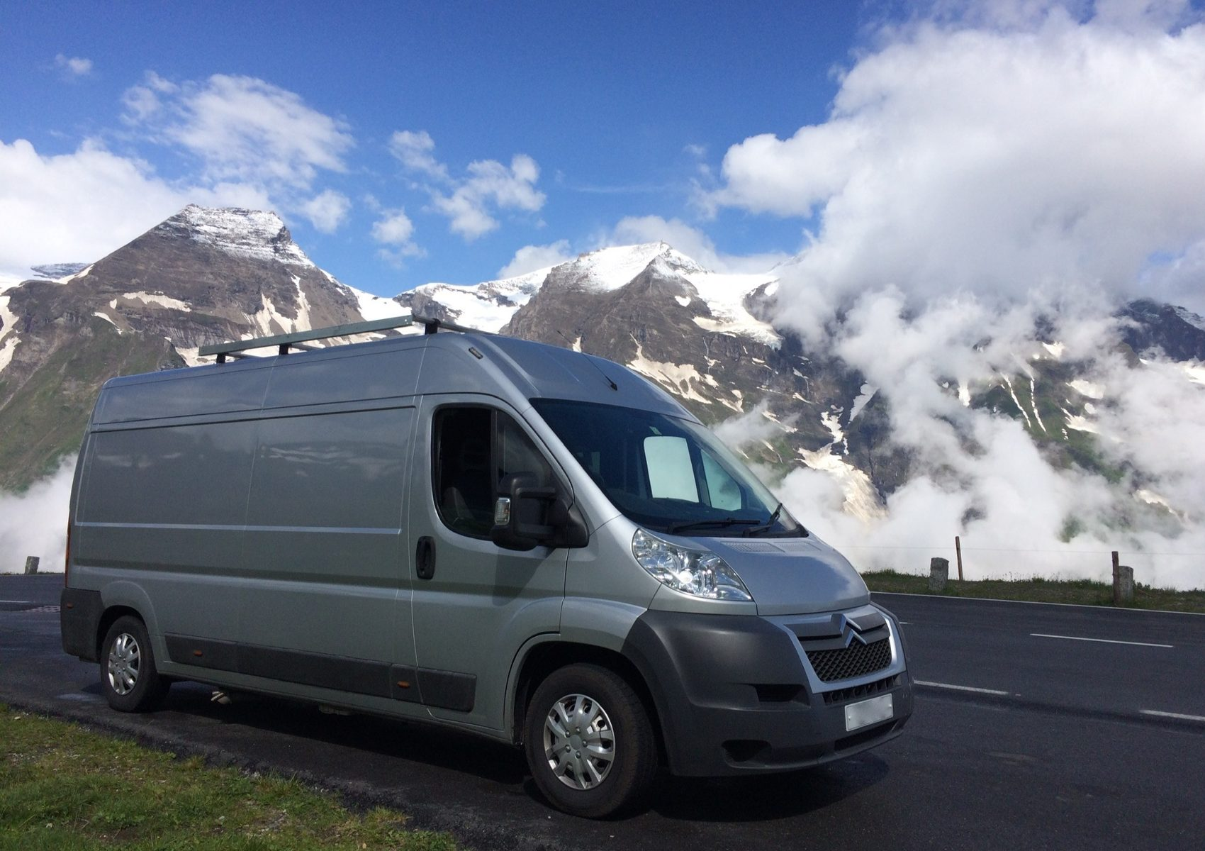 Motorhome in front of snowy mountains. Road Trip!