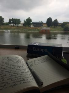 Updating travel logbook on a European Road Trip