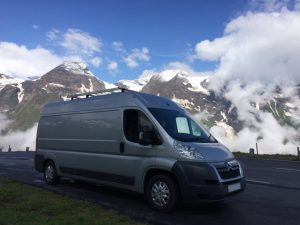 Citroen Relay (similar to the Fiat ducato, Peugeot Boxer) Self build campervan on a road trip parked in front of mountains
