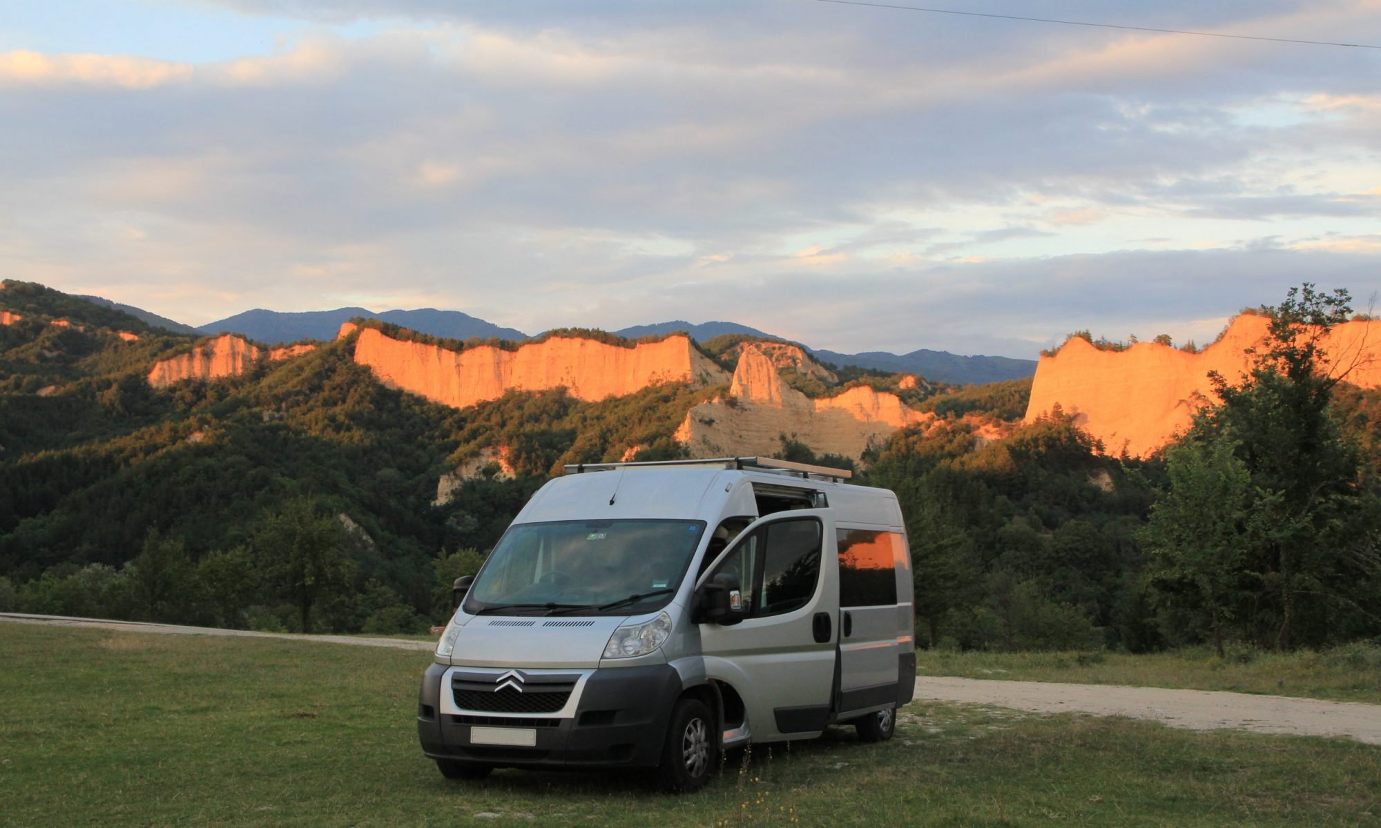 self build motorhome parked in front of golden mountains
