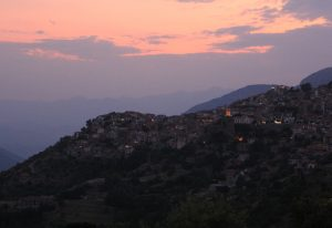 Sunset over Arachova, Greece during a road trip around Europe in a self build Citroen Relay camper van.