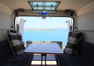 Self build campervan rear door view. Base vehicle is a Citroen Relay, Fiat Ducato, Peugeot Boxer, Ram ProMaster. Looking out the van across the Corinth canal. Road Trip around Greece