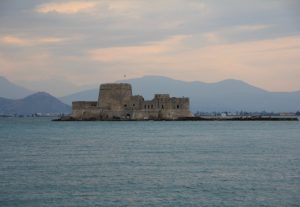 Nafplion Fort Bourtzi, Greece at sunset. Great location on our Road Trip around Europe in a self build camper van.