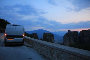 European Road Trip in a self build campervan. Base vehicle shows is a Citroen Relay, Fiat Ducato, Peugeot Boxer, Ram ProMaster. Parked overlooking Meteora