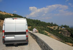 European Road Trip in a self build campervan. Base vehicle shows is a Citroen Relay, Fiat Ducato, Peugeot Boxer, Ram ProMaster. Sitting, enjoying the view over Meteora on our European Road Trip.