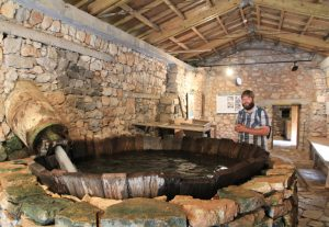 inside the outdoor water power museum in Dimitsana, Greece.