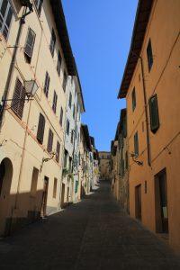 Deserted side street in Siena, Italy
