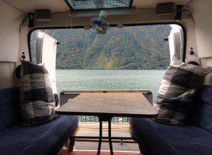 self build motorhome rear door view over lake lugano in Switzerland